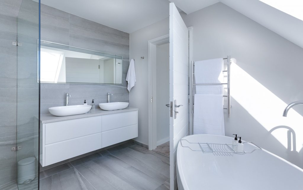 Bathroom accessories in a white bathroom.